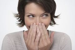 Shy Woman Looking Sideways Stock Image