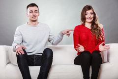 Shy woman and man sitting on sofa. First date. Shy women and men sitting on sofa couch next each other. First date. Attractive girl and handsome guy meeting Royalty Free Stock Photo