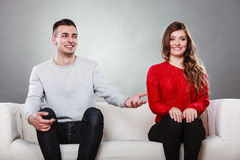 Shy woman and man sitting on sofa. First date. Shy women and men sitting on sofa couch next each other. First date. Attractive girl and handsome guy meeting Stock Image