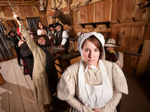Shy Woman in Rowdy Tavern. Shy women with rowdy people in an old west saloon Stock Photography