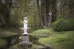 Shy woman sculpture in park. Royalty Free Stock Photography