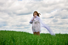 Shy woman in white Royalty Free Stock Images