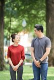 Couple walking in park stock image