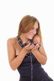 Shy young girl with a lot of necklaces around her neck Royalty Free Stock Photography