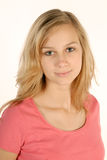 Shy young girl. Portraet of a shy blonde girl stock photo