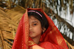 Shy young girl in red sari Stock Photo