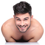 Shy young naked man smiling to the camera stock images
