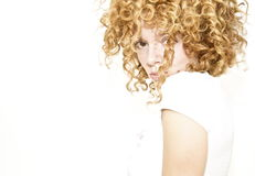 Shy young woman with curly hair stock photos