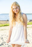 Shy young woman in dress with hairs Royalty Free Stock Image