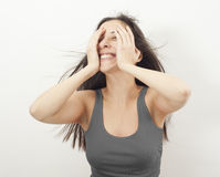 Shy young woman hiding face Stock Photo