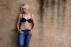 Shy young woman Stock Images