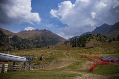 Shymbulak ski resort at early autumn time. Cableway in the mount Stock Photo