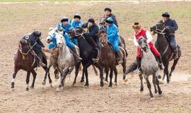Shymkent, il KAZAKISTAN - 22 marzo 2017: Celebrazione della festa kazaka NARIYZ Concorsi sui cavalli Fotografie Stock Libere da Diritti