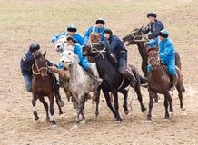 Shymkent, il KAZAKISTAN - 22 marzo 2017: Celebrazione della festa kazaka NARIYZ Concorsi sui cavalli Fotografia Stock