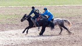 Shymkent, il KAZAKISTAN - 22 marzo 2017: Celebrazione della festa kazaka NARIYZ Concorsi sui cavalli Fotografia Stock Libera da Diritti