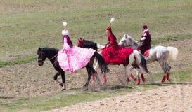 Shymkent, KASACHSTAN - 22. März 2017: Feier des kasachischen Feiertags NARIYZ Wettbewerbe auf Pferden lizenzfreies stockfoto