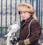 Shymkent, KAZAKHSTAN - 22 March 2017: People Celebrating the Kazakh holiday NARIYZ. Boy with a hawk Royalty Free Stock Photography