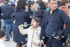 Shymkent, KAZAKHSTAN - 22 March 2017: People Celebrating the Kazakh holiday NARIYZ. Girl with soap bubbles Royalty Free Stock Photos