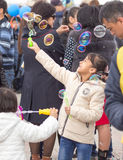 Shymkent, KAZAKHSTAN - 22 March 2017: People Celebrating the Kazakh holiday NARIYZ. Girl with soap bubbles Stock Image