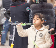 Shymkent, KAZAKHSTAN - 22 March 2017: People Celebrating the Kazakh holiday NARIYZ. Girl with soap bubbles Royalty Free Stock Photo