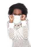 Shyness. A shy woman hiding her face with her jumper's collar Stock Photo