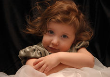 Shyness. Young girl being shy for the camera Royalty Free Stock Photography