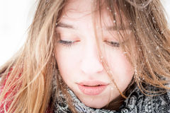 Shyness. Winter portrait of young beautiful girl with snow Royalty Free Stock Image