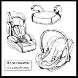 Sièges de voiture pour le bébé sur le fond blanc Image libre de droits