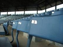 Sièges verts de stade Photographie stock libre de droits