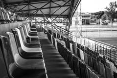Sièges verts de stade Photographie stock