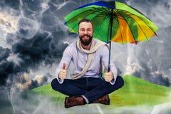 Siéntese en la lluvia Imagenes de archivo