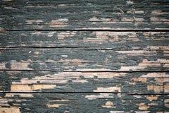 Si imbarca sul fondo delle crepe di orizzontale con il peeli grunged blu scuro Fotografia Stock