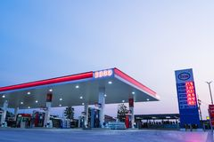 Si Racha, Chonburi /Thailand - April 18, 2018: ESSO gas station. With blue sky background during. Esso gas stations and products including gasoline, diesel stock photos