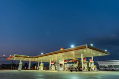 Si Racha, Chonburi /Thailand - April 18, 2018: Shell gas station. Blue sky background during sunset. Royal Dutch Shell sold its Australian Shell retail royalty free stock image
