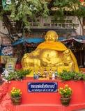 Golden Buddha down from Wat Koh Loy shrines on Ko Loi Island, Si Racha, Thailand