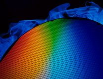 SI wafer. Detail of a silicon chip wafer reflecting different colors Royalty Free Stock Image