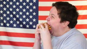 Sia a dieta il guasto del hamberger mangiatore di uomini grasso degli alimenti a rapida preparazione Alimento nazionale americano archivi video