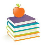 Sia libri e mela astuti Fotografia Stock