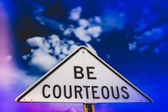 Sia segno di Courtous fotografia stock libera da diritti