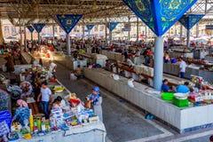 Siab Bazaar market, Samarkand, Uzbekistan. SAMARKAND, UZBEKISTAN - AUGUST 28: Stalls at Siab bazaar, local fruit, vegetable and spices market with people buying Stock Photography