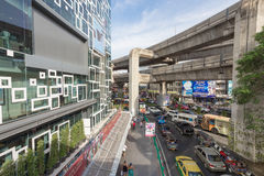 Siam Discovery in Bangkok. Bangkok, Thailand - May 29, 2016: Traffic outside the new mall called 'Siam Discovery' in Bangkok city. The sky train rail cross Stock Photography
