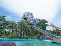 Castle Lion and Tiger Tower face in front of Themepark with beautiful sky. Siam Park City, Bangkok, Thailand - July 2016 : Castle Lion and Tiger Tower face in Stock Photography