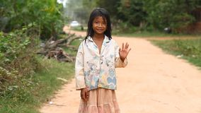 Siam Reap, Cambodia - January 13, 2017: Video portrait of a little Cambodian girl . Children from poor villages and