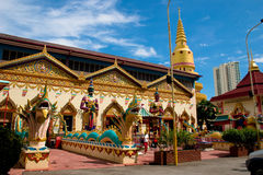 Siam temple with dragon 2. Intricate siamese buddhist temple penang with an oriental stone dragon Stock Image