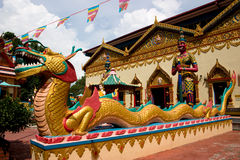 Siam temple with dragon. Intricate siamese buddhist temple penang with an oriental stone dragon Stock Photo