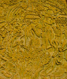 Siamesische Artmoral schnitzt auf der Steinwand. Lizenzfreies Stockfoto