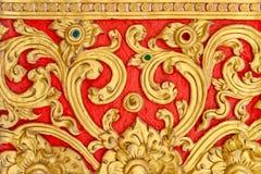 Siamesische Zeile auf einer Tempelwand Stockbilder