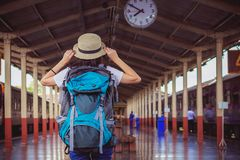 Sian girl travelers looking for overhead clock while waiting stock images