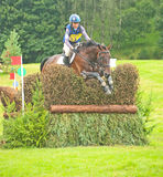 Sian Wynne Morris riding at Blair Castle. Sian Wynne Morris number 116  riding for Great Britain at Blair Castle International Horse Trial jumping the hedge in Stock Image