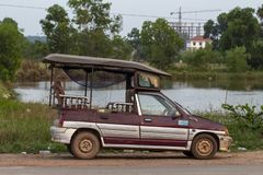 Sianoukville, Cambodia - 03 April 2018: local taxi car tuk-tuk parked on street. Cambodian transport. Traditional tuktuk car in Asia. Travel around cambodian royalty free stock image